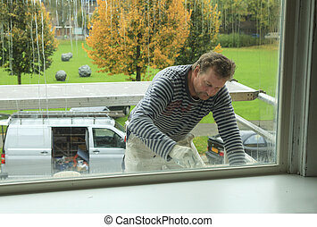 Professional painter outdoors - Painter working outdoors on...