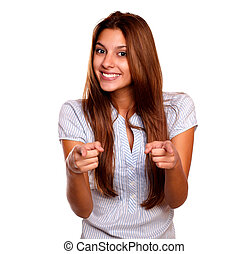 Charming young woman looking and pointing at you - Portrait...