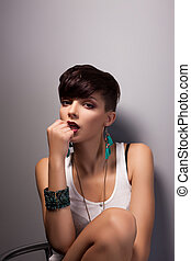 Attractive Modern Woman with Bob Hairstyle Daydreaming