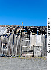 Decrepit Barn Detail - A detail of an old abandoned barn in...