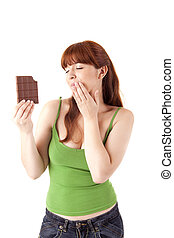 Beautiful young woman holding chocolate on white background