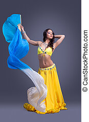 Beauty dancer in yellow costume dance with fantail