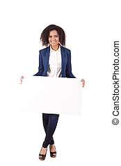 Young african american woman with blank signboard, isolated...
