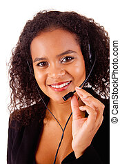 Beautiful african call center woman at work smiling with...