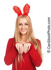 Beautiful young woman wearing bunny ears. Studio shot over...