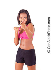 Athletic african woman showing her good shape