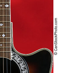 guitar - a part of a guitar on a red background