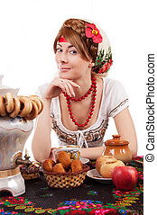 Hospitable russian woman welcomes to drinking tea with...