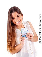 Portrait of a happy woman with a fan of Euros currency notes