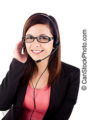 Portrait of a happy young call centre employee smiling with...