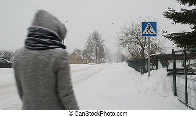 woman cross street winter