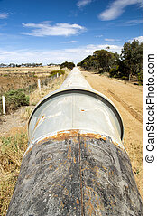 Water Pipeline - Large water pipeline above ground in rural...