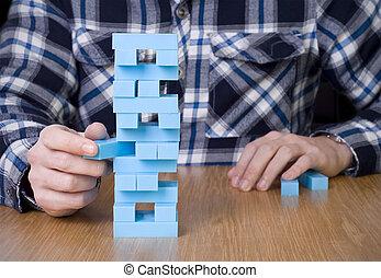 building blocks game - man playing building blocks game on...