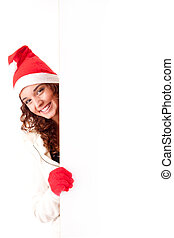 Beautiful smiling young christmas woman leaning on blank...