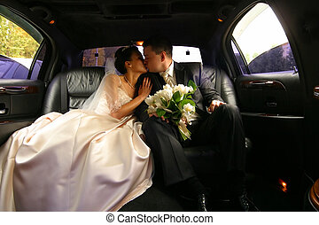 Newly married pair - Kiss of a newly-married couple in car