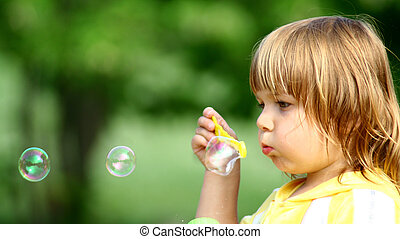 Little Girl making Soap Bubbles - Cute Little Girl with Soap...