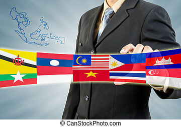 ASEAN Economic Community in businessman hand - ASEAN...