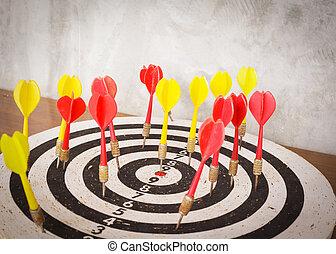 Success concept, darts hit target on dartboard