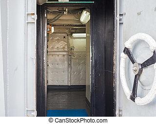 Handle of white ship door open inside
