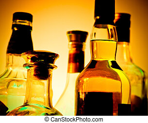 Bar bottles - Row of bottles at a bar over yellow background...