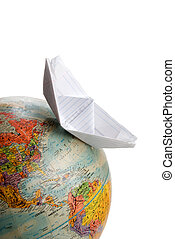World Travel - A boat sailing across a globe of the world.
