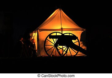 Ghosts of the Past - Glowing lights inside tent create a...
