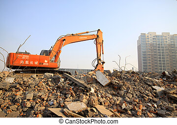 excavator in the construction debris clean up site