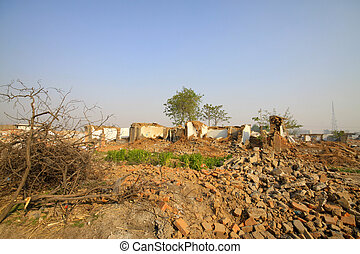 housing demolition materials in the demolition site, take...