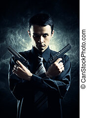 Killer with two pistols on dark background