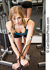 Young pretty caucasian woman exercising