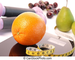 Scale with fresh fruits - Orange on a scale with fresh...