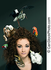 Zoo Concept - Safari - photo of beautiful curly woman with...