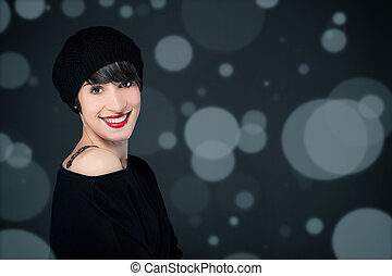 Smiling girl with french style outfit over sparkling...