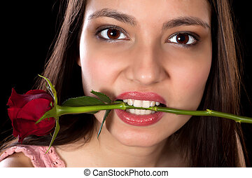 Red rose in her mouth