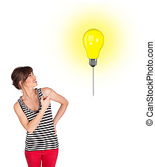 Happy woman holding a light bulb balloon - Happy young woman...