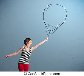 Beautiful woman holding balloon drawing - Beautiful young...