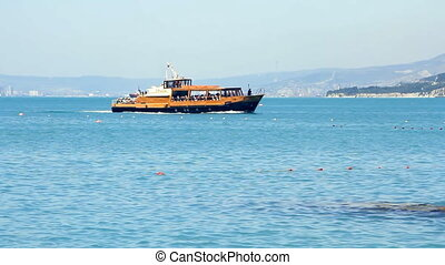 Pleasure boat floats on the sea