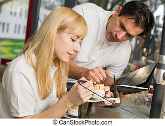 Instructor teaching an apprentice in dental lab - Dental...