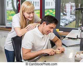 Dental technician watching her friend at work - Dental...