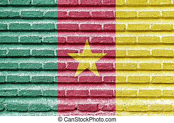 Cameroon flag on an old brick wall