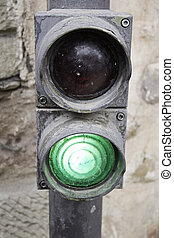 Green light lit pedestrian crossing, traffic signal