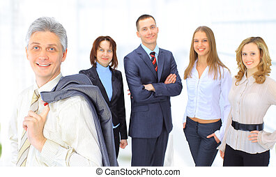 business people in the office. - A group of business people...