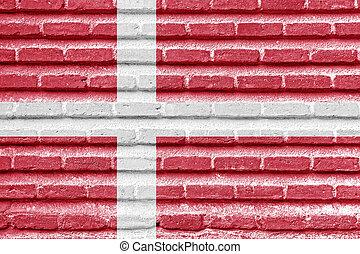 Denmark flag on an old brick wall