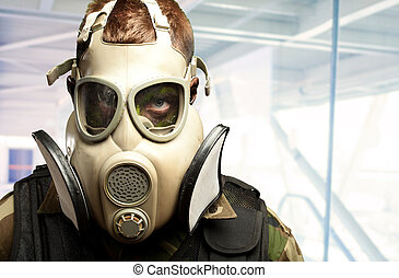 Close-up Of Soldier Wearing Mask against an abstract...