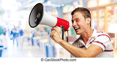 Portrait Of A Handsome Young Man Shouting With Megaphone,...