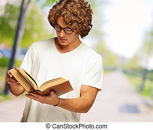 Young Man Reads A Book, Outdoor