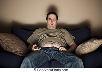 Overweight slob watching TV - Overweight slob watches TV...