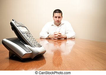 Man waits for a call