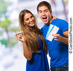 Couple Holding Boarding Pass, outdoor