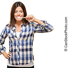 Young Woman Brushing Her Teeth against a white background